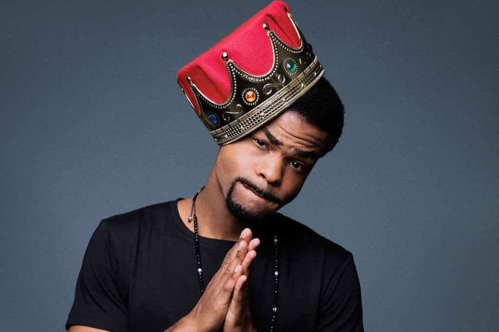 Andrew Bachelor - King Bach, wearing a crown, posing for a picture