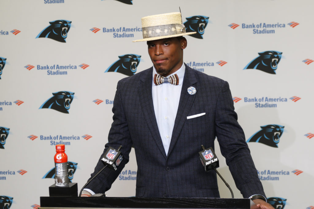 Carolina Panthers' Cam Newton talks to the media after an NFL football game against the San Francisco 49ers in Charlotte, N.C., Sunday, Sept. 18, 2016.