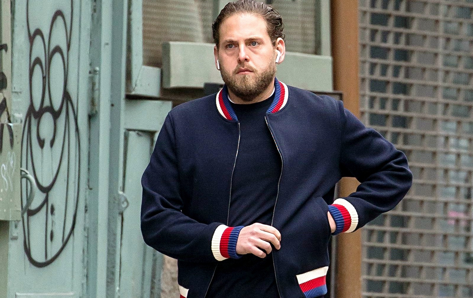 Jonah Hill taking a walk outside