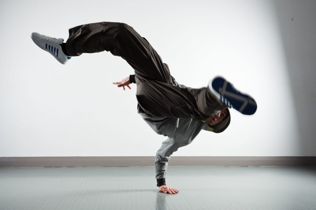 Young man doing a breakdance pose