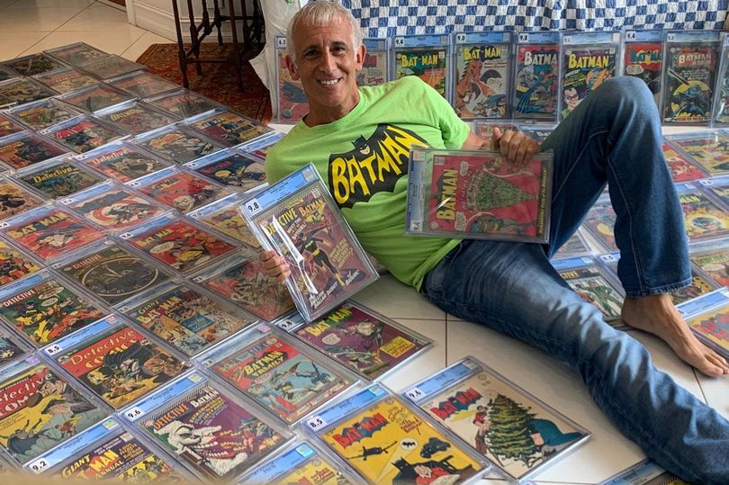 60-year-old superhero comic collector, Randy Lawrence pictured with his collection